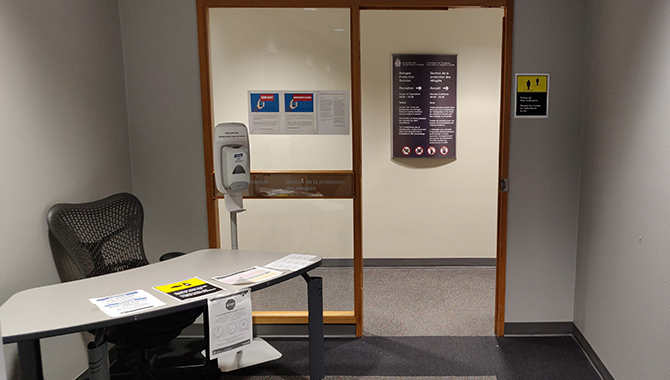 Near the elevator lobby, there is a screening station with a hand sanitizer and 2-metre physical distancing sign to remind you to wash your hands before and after accessing the public areas.
