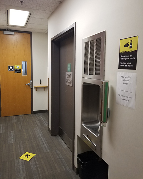 Upon arrival on the 11th floor in our Ottawa location, there will be a screening station with plexiglass and signs pointing you to wash or sanitize your hands. Behind the screening station, there is an exit door sign as a reminder to keep moving in one direction only.