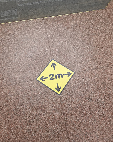 This is an image of the 2-metre physical distancing signs on the floors, found throughout the building.